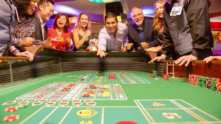 a group of people playing craps