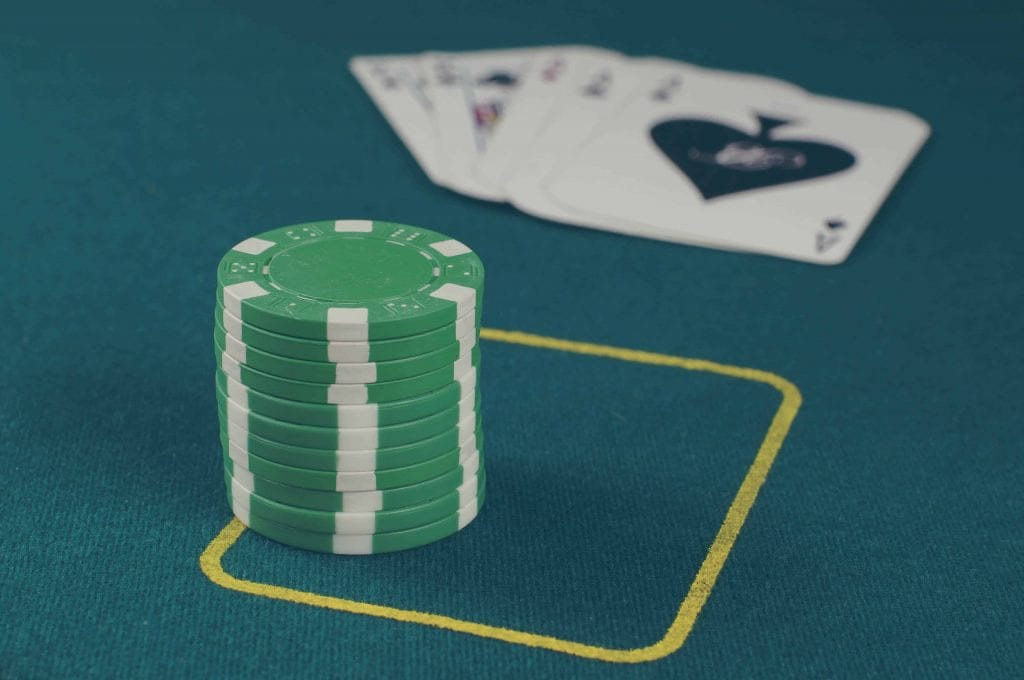 green poker chips stacked