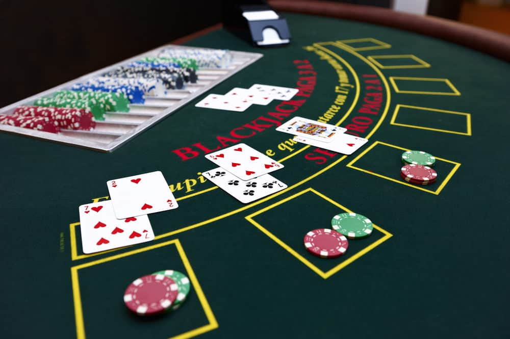 a blackjack table with poker cards and chips all over it
