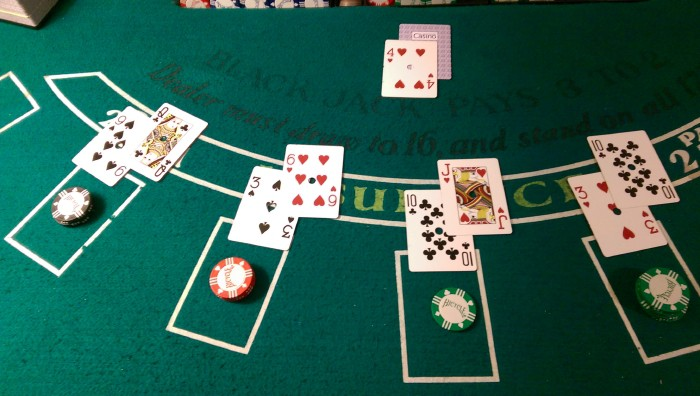 a blackjack table with poker cards and chips on it