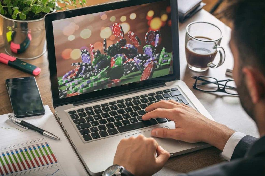 a man gambling on his laptop